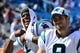 Sep 22, 2013; Charlotte, NC, USA; Carolina Panthers quarterback Cam Newton (1) with punter Brad Nortman (8) on the sidelines late in the fourth quarter. The Carolina Panthers defeated the New York Giants 38-0 at Bank of America Stadium. Mandatory Credit: Bob Donnan-USA TODAY Sports
