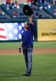Sep 23, 2013; Arlington, TX, USA; Country music singer Tracy Lawrence acknowledges the crowd after performing the National Anthem before the baseball game between the Texas Rangers and the Houston Astros at Rangers Ballpark in Arlington. Mandatory Credit: Jim Cowsert-USA TODAY Sports