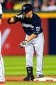 Sep 23, 2013; Atlanta, GA, USA; Milwaukee Brewers right fielder Norichika Aoki (7) reacts to a double in the fifth inning against the Atlanta Braves at Turner Field. Mandatory Credit: Daniel Shirey-USA TODAY Sports