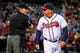 Sep 23, 2013; Atlanta, GA, USA; Atlanta Braves manager Fredi Gonzalez (33) argues with home plate umpire Angel Ramirez (55) after being thrown out in the seventh inning against the Milwaukee Brewers at Turner Field. Mandatory Credit: Daniel Shirey-USA TODAY Sports