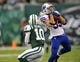 Sep 22, 2013; East Rutherford, NJ, USA;  Buffalo Bills defensive back Jim Leonhard (35) intercepts a pass for New York Jets wide receiver Santonio Holmes (10) during the first half at MetLife Stadium. Mandatory Credit: Robert Deutsch-USA TODAY Sports