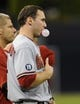 Sep 23, 2013; San Diego, CA, USA; Arizona Diamondbacks first baseman Paul Goldschmidt (44) blows a bubble during the National Anthem prior to the game against the San Diego Padres at Petco Park. Mandatory Credit: Christopher Hanewinckel-USA TODAY Sports