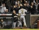 Sep 23, 2013; Chicago, IL, USA; Pittsburgh Pirates left fielder Starling Marte (6) is greeted after hitting a go ahead home run against the Chicago Cubs during the ninth inning at Wrigley Field. Mandatory Credit: David Banks-USA TODAY Sports