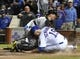Sep 23, 2013; Chicago, IL, USA; Pittsburgh Pirates catcher Russell Martin (55) tags out Chicago Cubs right fielder Nate Schierholtz (19) at home plate to end the game at Wrigley Field. The Pittsburgh Pirates defeated the Chicago Cubs 2-1.Mandatory Credit: David Banks-USA TODAY Sports