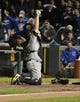 Sep 23, 2013; Chicago, IL, USA; Pittsburgh Pirates catcher Russell Martin (55) tags out Chicago Cubs right fielder Nate Schierholtz (not pictured) at home plate to end the game at Wrigley Field. The Pittsburgh Pirates defeated the Chicago Cubs 2-1.Mandatory Credit: David Banks-USA TODAY Sports