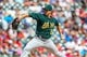 Sep 15, 2013; Arlington, TX, USA; Oakland Athletics starting pitcher Tommy Milone (57) throws during the game against the Texas Rangers at Rangers Ballpark in Arlington. Oakland won 5-1. Mandatory Credit: Kevin Jairaj-USA TODAY Sports