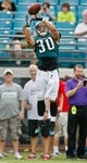 Aug 24, 2013; Jacksonville, FL, USA; Philadelphia Eagles safety Colt Anderson (30) catches a pass prior to the start of their game against the Jacksonville Jaguars at EverBank Field. The Philadelphia Eagles beat the Jacksonville Jaguars 31-24. Mandatory Credit: Phil Sears-USA TODAY Sports