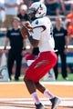 Sep 7, 2013; Champaign, IL, USA; Cincinnati Bearcats quarterback Munchie Legaux (4) during the game against Illinois Fighting Illini at Memorial Stadium. Mandatory Credit: Bradley Leeb-USA TODAY Sports