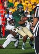 Sep 21, 2013; Waco, TX, USA; Baylor Bears wide receiver Jay Lee (4) is tackled by Louisiana Monroe Warhawks safety Lenzy Pipkins (31) during the game at Floyd Casey Stadium. The Bears defeated the Warhawks 70-7. Mandatory Credit: Jerome Miron-USA TODAY Sports