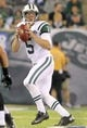 Aug 17, 2013; East Rutherford, NJ, USA; New York Jets quarterback Matt Simms (5) drops back to pass against the Jacksonville Jaguars during the fourth quarter of a preseason game at MetLife Stadium. The Jets defeated the Jaguars 37-13. Mandatory Credit: Brad Penner-USA TODAY Sports