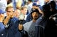 Sep 24, 2013; Atlanta, GA, USA; Milwaukee Brewers right fielder Norichika Aoki (7) high fives with teammates in the dugout after scoring a run against the Atlanta Braves during the third inning at Turner Field. Mandatory Credit: Dale Zanine-USA TODAY Sports