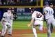 Sep 24, 2013; Atlanta, GA, USA; Atlanta Braves left fielder Evan Gattis (24) gets caught in a run down between Milwaukee Brewers third baseman Aramis Ramirez (16) and second baseman Scooter Gennett (2) during the fourth inning at Turner Field. Mandatory Credit: Dale Zanine-USA TODAY Sports