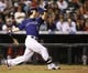 Sep 24, 2013; Denver, CO, USA; Colorado Rockies left fielder Corey Dickerson (6) hits a home run during the fourth inning against the Boston Red Sox at Coors Field. Mandatory Credit: Chris Humphreys-USA TODAY Sports