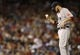 Sep 24, 2013; Denver, CO, USA; Boston Red Sox pitcher John Lackey (41) reacts on the mound during the fourth inning against the Colorado Rockies at Coors Field. Mandatory Credit: Chris Humphreys-USA TODAY Sports