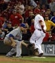 Sep 24, 2013; Cincinnati, OH, USA; Cincinnati Reds third baseman Todd Frazier (right) tags safely at first in front of New York Mets first baseman Lucas Duda (left) at Great American Ball Park. Mandatory Credit: David Kohl-USA TODAY Sports