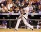Sep 24, 2013; Denver, CO, USA; Boston Red Sox first baseman David Ortiz (34) hits a single during the ninth inning against the Colorado Rockies at Coors Field. The Rockies won 8-3.  Mandatory Credit: Chris Humphreys-USA TODAY Sports