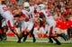 Sep 21, 2013; Piscataway, NJ, USA;  Arkansas Razorbacks quarterback AJ Derby (11) hands the ball off to running back Jonathan Williams (32) during the first half at High Points Solutions Stadium. Mandatory Credit: Jim O'Connor-USA TODAY Sports