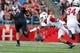 Sep 21, 2013; Piscataway, NJ, USA;  Rutgers Scarlet Knights running back Paul James (34) runs by Arkansas Razorbacks cornerback Tevin Mitchel (8) during the first half at High Points Solutions Stadium. Mandatory Credit: Jim O'Connor-USA TODAY Sports