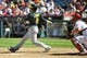 September 25, 2013; Anaheim, CA, USA; Oakland Athletics shortstop Jed Lowrie (8) hits a sacrifice RBI in the sixth inning against the Los Angeles Angels at Angel Stadium of Anaheim. Mandatory Credit: Gary A. Vasquez-USA TODAY Sports