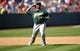 September 25, 2013; Anaheim, CA, USA; Oakland Athletics second baseman Alberto Callaspo (18) throws to first to complete an out in the eighth inning against the Los Angeles Angels at Angel Stadium of Anaheim. Mandatory Credit: Gary A. Vasquez-USA TODAY Sports