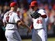 September 25, 2013; Anaheim, CA, USA; Los Angeles Angels relief pitcher Ernesto Frieri (49) and catcher Chris Iannetta (17) celebrate the 3-1 victory against the Oakland Athletics at Angel Stadium of Anaheim. Mandatory Credit: Gary A. Vasquez-USA TODAY Sports