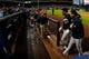 Sep 25, 2013; Atlanta, GA, USA; Milwaukee Brewers center fielder Carlos Gomez (27) is walked off the field by team mates after confronting  Atlanta Braves players after hitting a home run during the first inning at Turner Field. Mandatory Credit: Dale Zanine-USA TODAY Sports