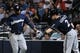 Sep 25, 2013; Atlanta, GA, USA; Milwaukee Brewers third baseman Yuniesky Betancourt (3) shakes hands with second baseman Scooter Gennett (2) after scoring a run against the Atlanta Braves during the fourth inning at Turner Field. Mandatory Credit: Dale Zanine-USA TODAY Sports