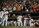 Sep 25, 2013; Baltimore, MD, USA; Baltimore Orioles third baseman Ryan Flaherty (3) is congratulated by teammates after hitting a two-run home run in the third inning against the Toronto Blue Jays at Oriole Park at Camden Yards. Mandatory Credit: Joy R. Absalon-USA TODAY Sports