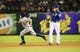 Sep 25, 2013; Arlington, TX, USA; Houston Astros second baseman Jose Altuve (27) runs past Texas Rangers first baseman Mitch Moreland (18) during the game at Rangers Ballpark in Arlington. Mandatory Credit: Kevin Jairaj-USA TODAY Sports
