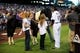 Sep 25, 2013; Denver, CO, USA; Colorado Rockies first baseman Todd Helton (17) reacts with his family after receiving a horse for retirement before the game against the Boston Red Sox at Coors Field. Mandatory Credit: Ron Chenoy-USA TODAY Sports