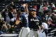 Sep 25, 2013; Atlanta, GA, USA; Milwaukee Brewers first baseman Sean Halton (11) and starting pitcher Kyle Lohse (26) react after defeating the Atlanta Braves at Turner Field. The Brewers defeated the Braves 4-0. Mandatory Credit: Dale Zanine-USA TODAY Sports