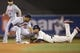 Sep 25, 2013; Minneapolis, MN, USA; Minnesota Twins shortstop Pedro Florimon (25) steals second base before Detroit Tigers second baseman Omar Infante (4) can make a tag in the fifth inning at Target Field. Mandatory Credit: Jesse Johnson-USA TODAY Sports