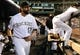 Sep 25, 2013; Denver, CO, USA; Colorado Rockies first baseman Todd Helton (17) takes to the field before the start of the game against the Boston Red Sox at Coors Field. Mandatory Credit: Ron Chenoy-USA TODAY Sports