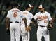 Sep 25, 2013; Baltimore, MD, USA; Baltimore Orioles teammates Jonathan Schoop (left) and Nick Markakis (right) celebrate after a game against the Toronto Blue Jays at Oriole Park at Camden Yards. The Orioles defeated the Blue Jays 9-5. Mandatory Credit: Joy R. Absalon-USA TODAY Sports