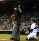 Sep 25, 2013; San Diego, CA, USA; Home plate umpire Mark Ripperger signals for a run to score following a balk by San Diego Padres starting pitcher Ian Kennedy (not pictured) during the fourth inning against the Arizona Diamondbacks at Petco Park. Mandatory Credit: Christopher Hanewinckel-USA TODAY Sports