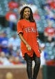 Sep 25, 2013; Arlington, TX, USA; Miss Texas Ivana Hall throws out the ceremonial first pitch before the game against the Houston Astros at Rangers Ballpark in Arlington. Mandatory Credit: Kevin Jairaj-USA TODAY Sports