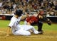 Sep 25, 2013; San Diego, CA, USA; San Diego Padres right fielder Will Venable (25) slides safely into home ahead of the tag by Arizona Diamondbacks catcher Miguel Montero (26) during the fifth inning at Petco Park. Mandatory Credit: Christopher Hanewinckel-USA TODAY Sports