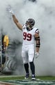 Sep 15, 2013; Houston, TX, USA; Houston Texans defensive end J.J. Watt (99) takes the field in smoke prior to the game against the Tennessee Titans at Reliant Stadium. Mandatory Credit: Matthew Emmons-USA TODAY Sports