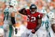 Sep 22, 2013; Miami Gardens, FL, USA; Atlanta Falcons middle linebacker Akeem Dent (52) reacts after his sack of Miami Dolphins quarterback Ryan Tannehill (not pictured) in the second half at Sun Life Stadium. Miami won 27-23. Mandatory Credit: Robert Mayer-USA TODAY Sports