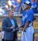 Sep 21, 2013; Kansas City, MO, USA; Kansas City Royals general manager Dayton Moore (left) talks with right fielder Junstin Maxwell (right) before a game against the Texas Rangers at Kauffman Stadium. Mandatory Credit: Peter G. Aiken-USA TODAY Sports