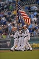Sep 20, 2013; Kansas City, MO, USA; A U.S. Navy color guard marches onto the field before a game between the Kansas City Royals and the Texas Rangers at Kauffman Stadium. Mandatory Credit: Peter G. Aiken-USA TODAY Sports