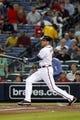 Sep 26, 2013; Atlanta, GA, USA; Atlanta Braves first baseman Freddie Freeman (5) hits a RBI double against the Philadelphia Phillies in the first inning at Turner Field. Mandatory Credit: Brett Davis-USA TODAY Sports