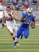 Sep 26, 2013; Tulsa, OK, USA; Tulsa Golden Hurricane running back Trey Watts (22) runs ahead of an Iowa State Cyclone defender during the first half against the Iowa State Cyclones at Skelly Field at H.A. Chapman Stadium. Mandatory Credit: Alonzo Adams-USA TODAY Sports