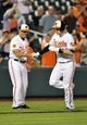 Sep 26, 2013; Baltimore, MD, USA; Baltimore Orioles catcher Matt Wieters (32) is congratulated by third base coach Bobby Dickerson (11) after hitting a solo home run in the second inning against the Toronto Blue Jays at Oriole Park at Camden Yards. Mandatory Credit: Joy R. Absalon-USA TODAY Sports