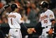 Sep 26, 2013; Baltimore, MD, USA; Baltimore Orioles second baseman Brian Roberts (1) is congratulated by Adam Jones (10) after scoring on a one-run rbi double by Nick Markakis (not shown) against the Toronto Blue Jays in the third inning at Oriole Park at Camden Yards. Mandatory Credit: Joy R. Absalon-USA TODAY Sports