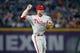 Sep 26, 2013; Atlanta, GA, USA; Philadelphia Phillies third baseman Cody Asche (25) throws a runner out at first against the Atlanta Braves in the third inning at Turner Field. Mandatory Credit: Brett Davis-USA TODAY Sports
