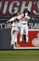 Sep 26, 2013; Baltimore, MD, USA; Baltimore Orioles outfielders Jason Pridie (left) Nick Markakis (right) and Adam Jones (rear) celebrate after a game against the Toronto Blue Jays at Oriole Park at Camden Yards. The Orioles defeated the Blue Jays 3-2. Mandatory Credit: Joy R. Absalon-USA TODAY Sports