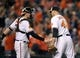 Sep 26, 2013; Baltimore, MD, USA; Baltimore Orioles catcher Matt Wieters (32) congratulates pitcher Jim Johnson (43) after a game against the Toronto Blue Jays at Oriole Park at Camden Yards. The Orioles defeated the Blue Jays 3-2. Mandatory Credit: Joy R. Absalon-USA TODAY Sports