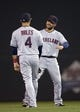 Sep 26, 2013; Minneapolis, MN, USA; Cleveland Indians first baseman Nick Swisher (33) talks with shortstop Mike Aviles (4) during a pitching change in the fifth inning against the Minnesota Twins at Target Field. Mandatory Credit: Jesse Johnson-USA TODAY Sports