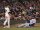 Sep 26, 2013; San Francisco, CA, USA; Los Angeles Dodgers left fielder Carl Crawford (25) slides into third base after hitting a triple against the San Francisco Giants during the first inning at AT&T Park. Mandatory Credit: Ed Szczepanski-USA TODAY Sports